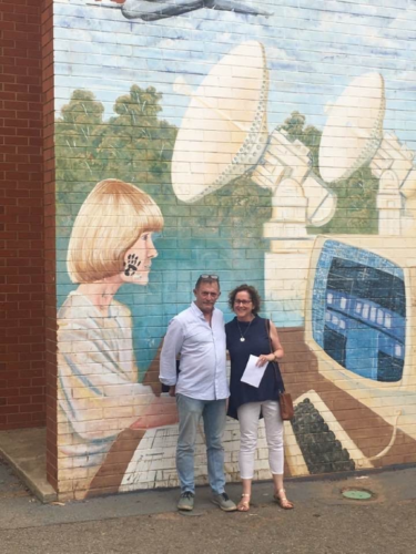ex students in front of D Block Mural